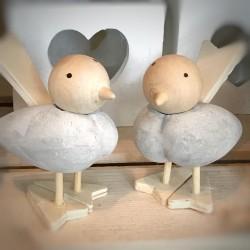 Uccellino in  cemento con testa mobile in legno